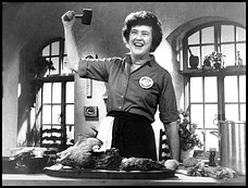 Julia Child wielding a mallet.